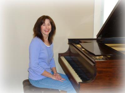 Elizabeth at her piano.